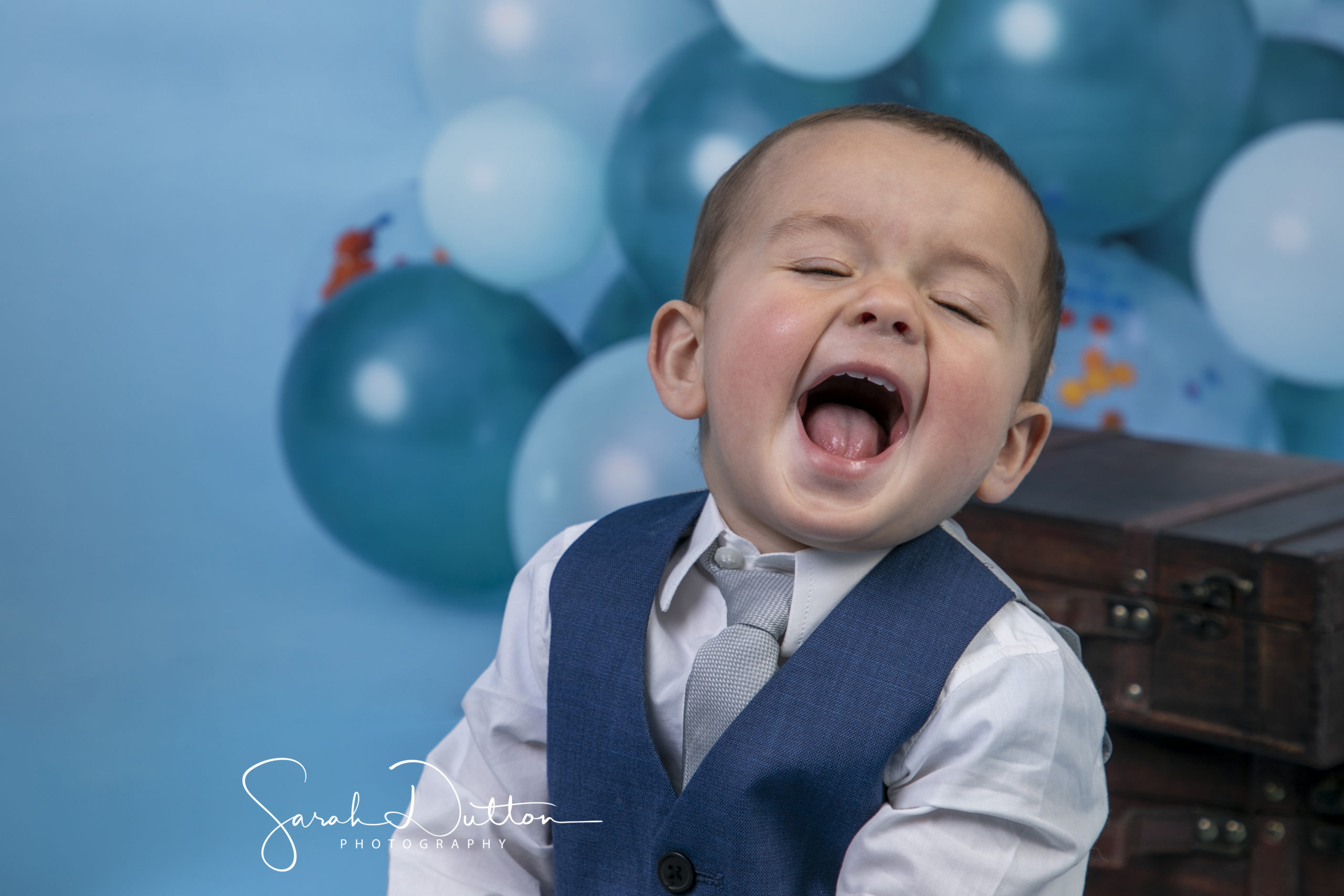 Cake Smash Baby photography portrait taken by photographer Sarah Dutton In her studio in Whitchurch Hampshire