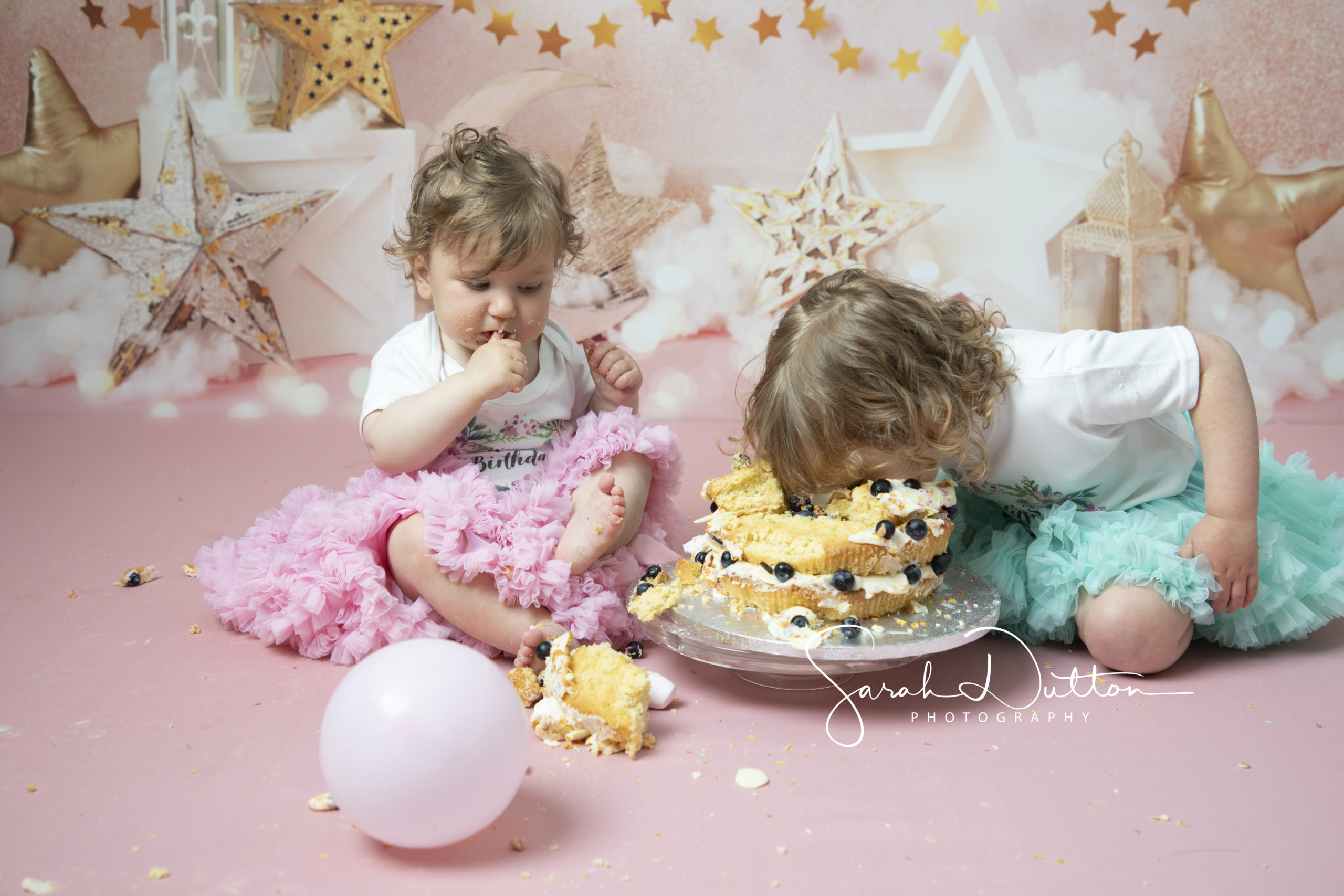 fun at a cake smash in a photographers studio in Whitchurch Hampshire taken by a professional photographer in her studio.